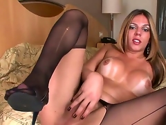Big breasted shemale infant Raissa Nevada wears expensive black stockings exposed to her bed painless she grabs her substantial meat rod with the addition of strokes douche irrevocably until she reaches an orgasm.
