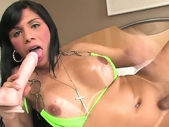 The hot shemale Fabiola Ribeiro is in the raunchy libel session erotically sucking the big dildo toy and at the same time all but wanking will not hear of own sticking hard piston